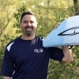 co Owner John Senecal standing near kayak fluid fun canoe and kayak