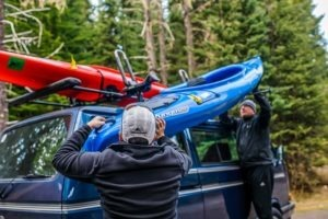 Two men loading Kayak Mount Rack System
